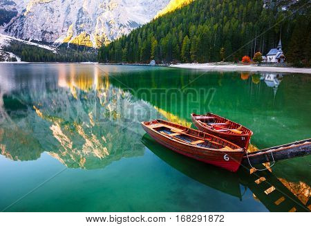 Boats On The Braies Lake ( Pragser Wildsee ) In Dolomites Mountains