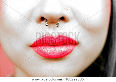 Lips of young woman wearing pink lipstick