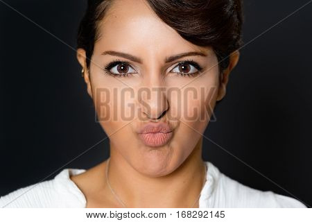 Beautiful woman with pucker lips facial expression