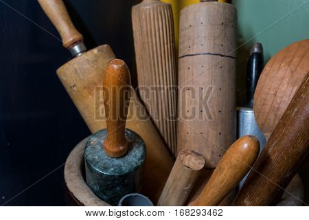 Crock of Rolling Pins in a variety of vintage styles
