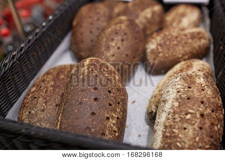 food, baking and sale concept - close up of rye bread at bakery or grocery store