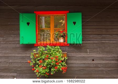 A typical wooden farmhouse window in alps