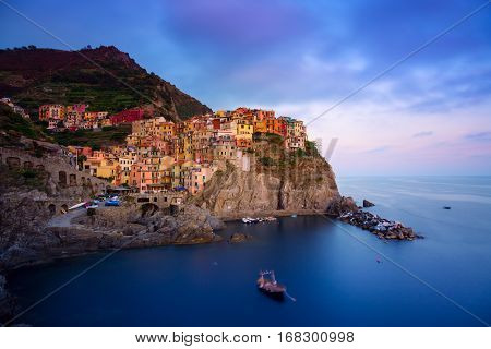 Manarola village at twilight. Manarola is a small town in the province of La Spezia Liguria northern Italy