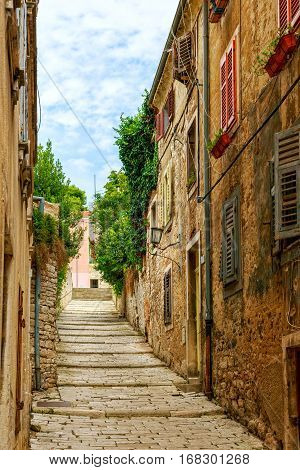 Cozy and narrow streets in Pula's medieval old town Croatia