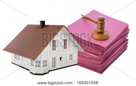 Judge gavel on stack of files with model house isolated on white background, for subprime loan crisis concept.