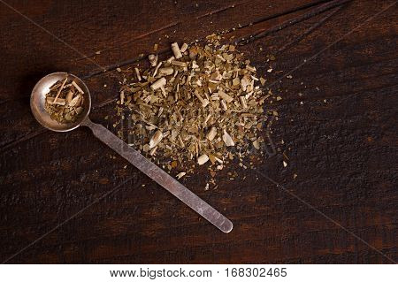 Mate With Spoon On Wooden Background