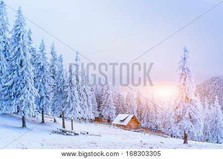 cabin in the mountains in winter, fabulous landscape