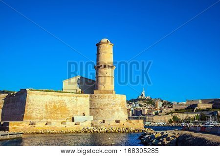 Fort St. John in Marseille. Most watchtower is reflected in the blue water port