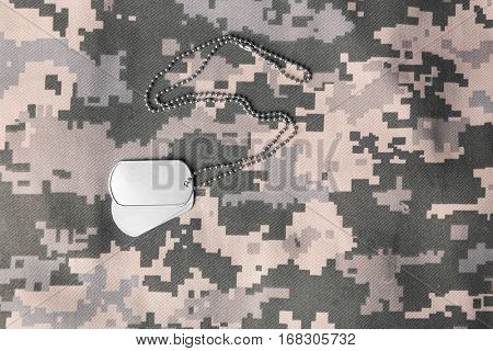 Military ID tag on uniform background