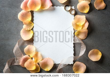 Wedding to do list with flower petals on grey background
