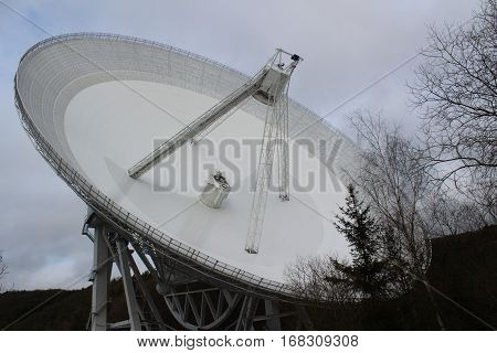 Radiotelescop Effelsberg largest fully mobile Radiotelcope of the earth in the Winter of 2017,100 meters diameter, gigantic moving bowl, in the background Effelsberg forest .