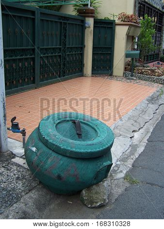 Rubber garbage can on the street side of the Philippines