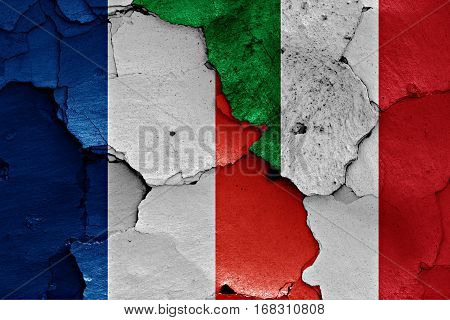 Flags Of France And Italy Painted On Cracked Wall