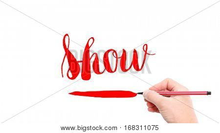 The verb show written on a white background