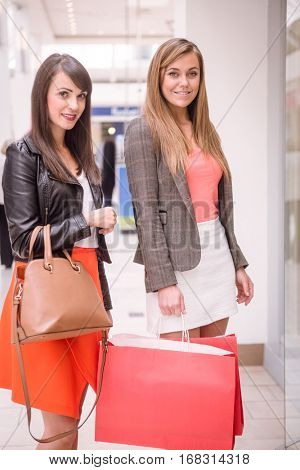 Portrait of beautiful women window shopping in mall