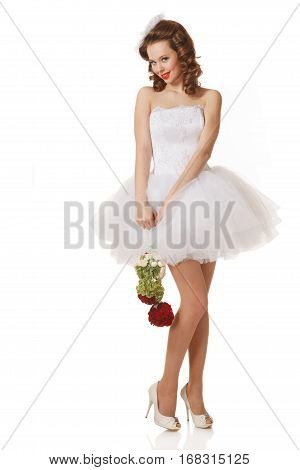 Excited Pin-up bride holds a bouquet.Professional make-up hair and style.Isolated in white