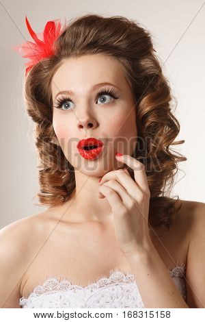 Surprised Pin-up girl studio shoot.Professional make-up hair and style