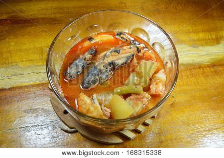 mullet with mixed vegetable in spicy soup on bowl