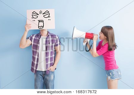 woman take the microphone shout to man take angrily billboard isolated on blue background