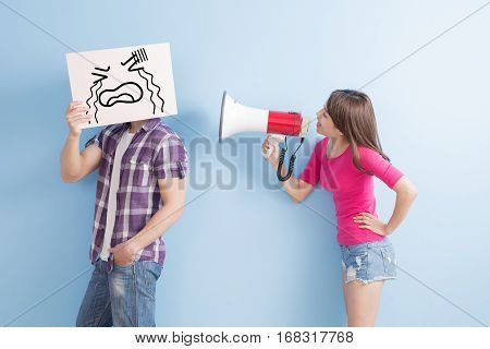 woman take the microphone shout to man angrily isolated on blue background