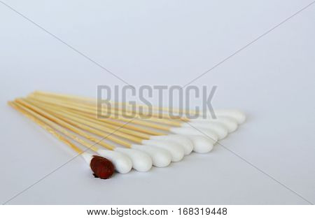 cotton bud with iodine solution on white background
