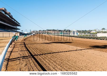 DEL MAR, CALIFORNIA - NOVEMBER 25, 2016:  Dirt race track, grandstand and tote board for this thoroughbred racing venue.