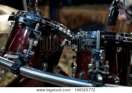 musical instruments and entertainment concept - drums at music studio