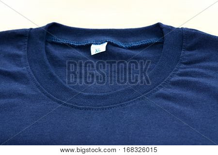 Dark blue cotton T-Shirt collar on white background