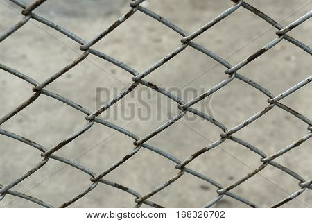 pattern of old steel mesh with rust.