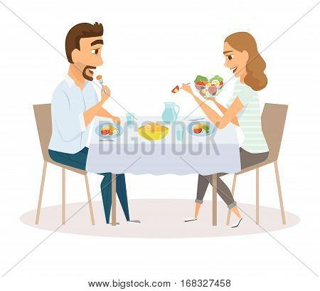 Loving couple eating meal in the kitchen table. Happy man and women sitting eating healthy lunch in home or restaurant. Diner family smile and laughing together.