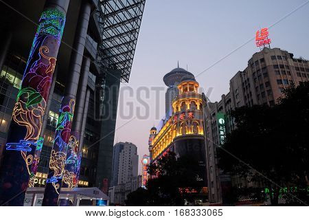 SHANGHAI - FEBRUARY 29: New World City Shopping Center at main pedestrian shopping street Nanjing Road in Shanghai, China, February 29, 2016.