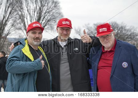 WASHINGTON DC - JANUARY 20: Men with slogan hats during Inauguration of Donald Trump. Taken January 20 2017 in District of Columbia.