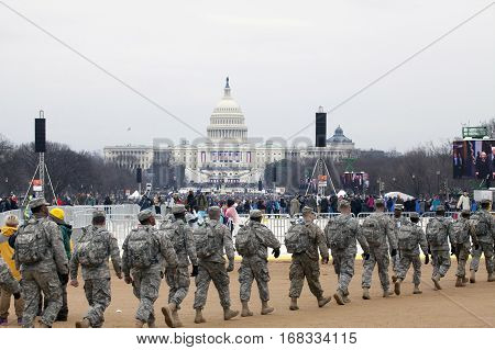 WASHINGTON DC - JANUARY 20: Soldiers walk in front of Capitol building during Inauguration of Donald Trump. Taken January 20 2017 in District of Columbia.