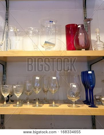 Glasses And Cups For Sale On A Shelf