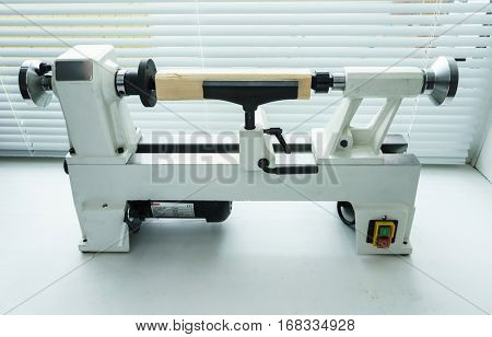 Woodworking Machine, Mini Woodworking Lathe Close Up Detail, Wood Shavings Tools, Woodworking Machinery, Small Woodwork Lathe in a Joinery Workshop, Woodwork on the Machine, Spindle Turning