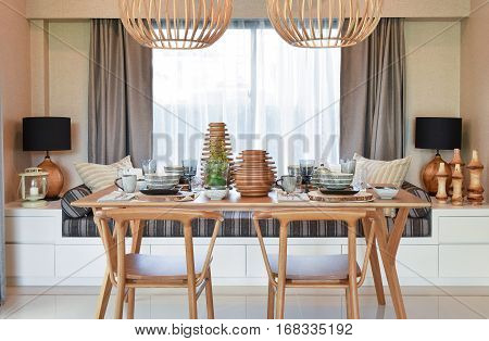 Dining Wooden Table And Comfortable Chairs In Modern Home With E