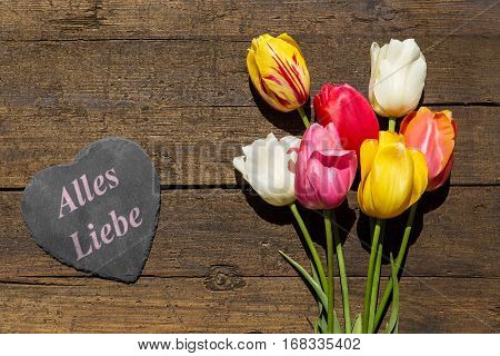 Bunch Of Tulips On A Wooden Table, Heart Bunch With German Words All Love