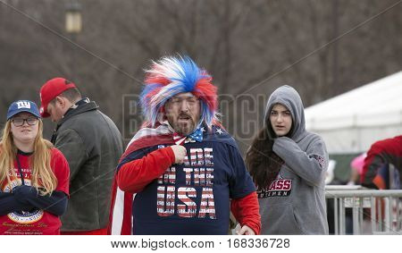 WASHINGTON DC - JANUARY 20: Man wearing red white and blue during Donald Trump Inauguration. Taken January 20 2017 in District of Columbia.
