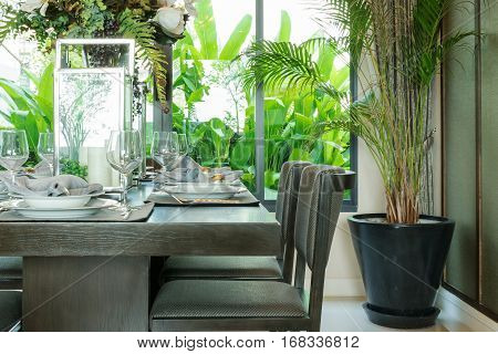 Table Set On Wooden Table And Chairs In Tropical Dinning Room