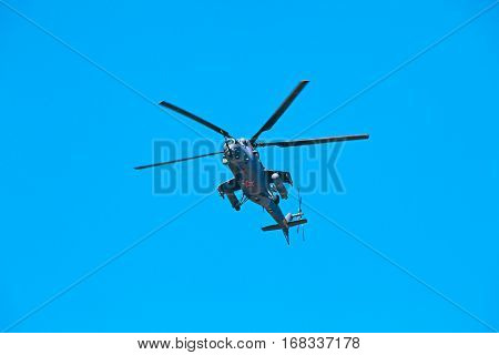 Black shark - militarian helicopter maneuver on blue sky