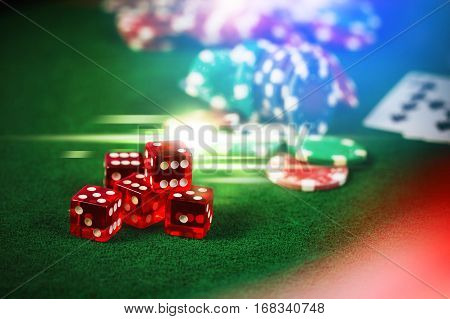Poker Chips In Casino Gamble Green Table With Colorful Multi Color Lighting Effect.