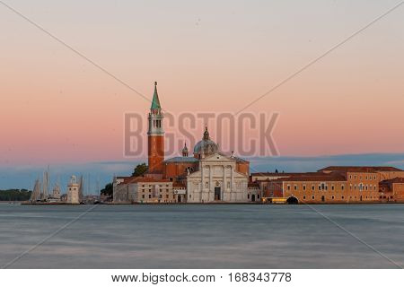 San Giorgio Maggiore church in Venice during beautiful  sunset with blurry Grand canal