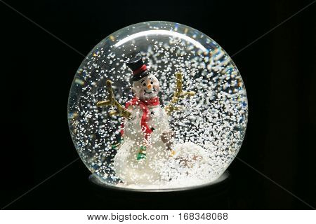 Winter Snow Globe With Snowman On Black