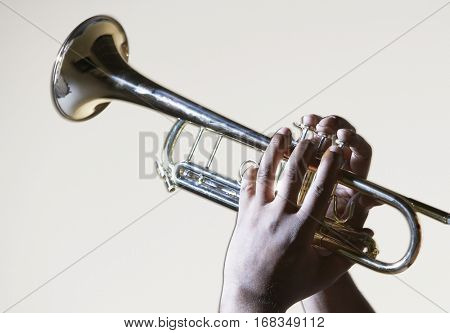 Hand playing trumpet