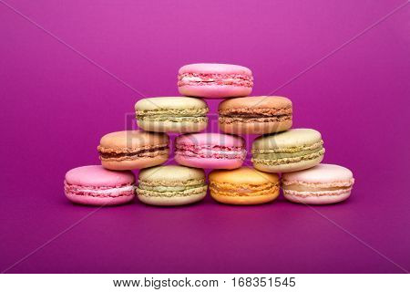 Pyramid Of Colorful Macaroons Or Macarons On Purple Background.