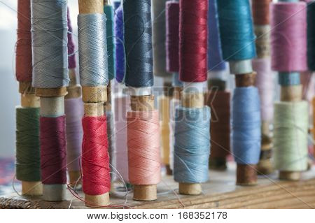 Sewing Multicolored Threads Of Soft Pastel Vintage Colors On Spools. Sewing Tailor Related Accessori