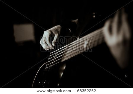 Guy plays guitar, black in white, soft focus