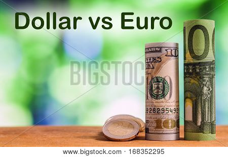 One Hundred Euro And One Hundred Us Dollar Rolled Bills Banknotes, With Euro Coins And American Cent