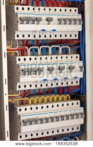 Electical distribution fuseboard. Electrical supplies. Electrical panel at a assembly line factory. Controls and switches. Electricity distribution box. Fusebox.