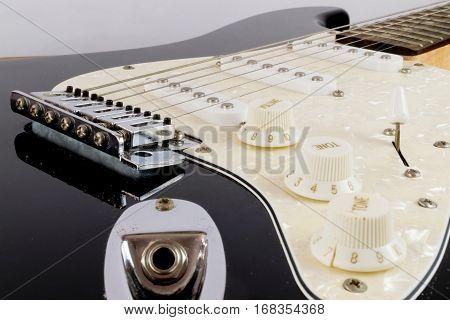 Shot of an electric guitar up close.